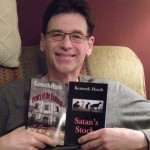 Ken Hursh holds two of the supernatural thriller novels he has written.