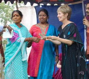Betsy Stewart (right) smiles as she awards micro loans to women in India.