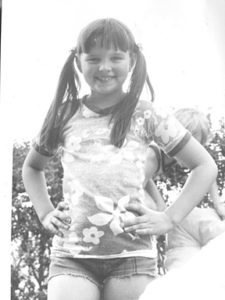 Whitney's sister Paige Thomas as a young girl of 7 or 8.