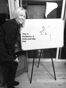 Lisa Cote draws Guillermo in customized LQ Pictionary  on game night.