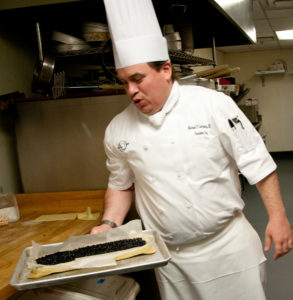 Chef Michael prepares for the New Year's Eve party. Photo by Mary Linda Boling