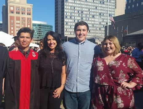 Hunter  Griggs-Bible (left) and his happy family on graduation day.