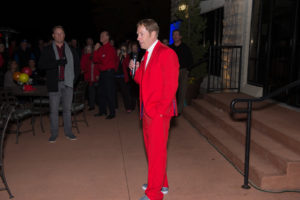 Mayor Olson, wearing a bright red suit, welcoms the crowd  and introduces LQ Volunteer Fire Department members,  past and present. Photo by Dieter Kinner.