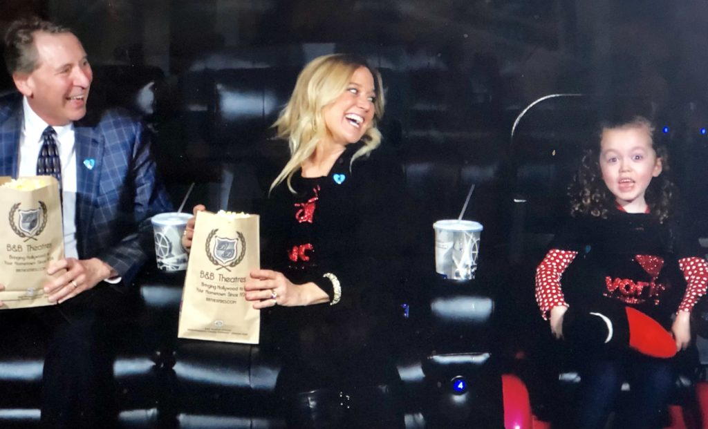 LQ member Deb Wiebrecht (center), Executive Director of Variety KC, is featured in a  B & B Theatre drink and popcorn promotion to benefit Variety KC.