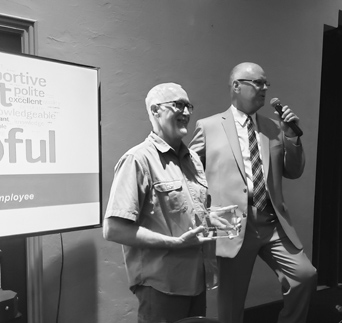 Gary Anderson (left) is the recipient of the first-ever LQ Outstanding Enployee Award.