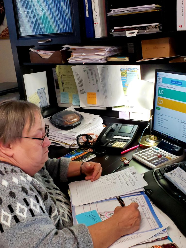 Debbie Peed's day--planner keeps her organized and on task. Off work, she escapes to fiction and biography.