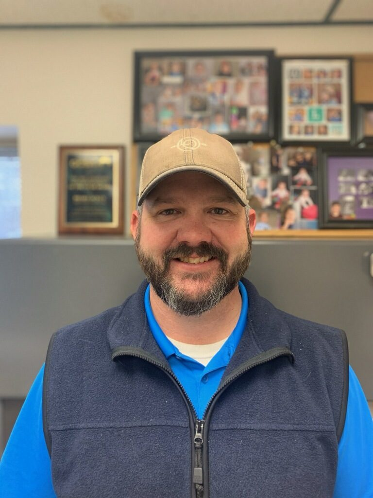 Brad Lackey, Golf Course Superintendent, in his maintence office, anticipating a slow-down with golf course play and imminent weather ahead.