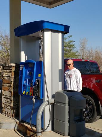0420 man filling gas