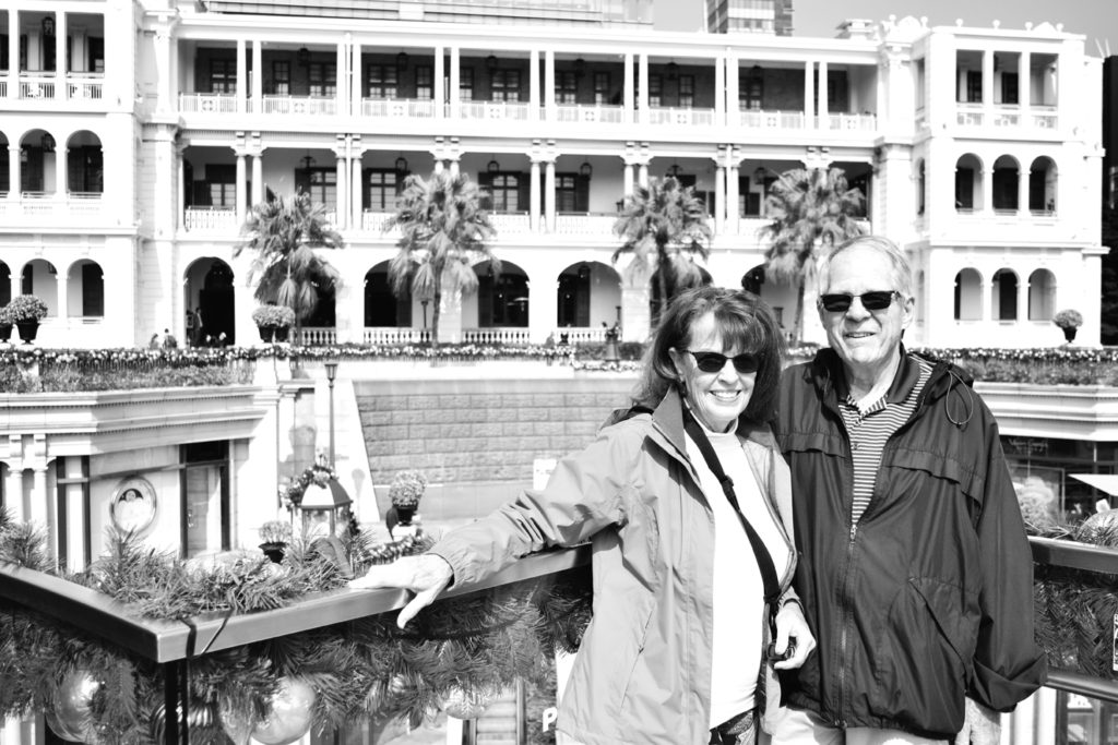 Susan and Wayne Hidalgo in front of the Fullerton Hotel in Singapore the day before boarding the Diamond Princess cruise ship.